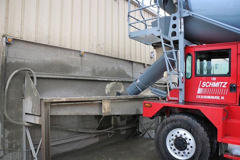 Concrete truck utilizing washout system